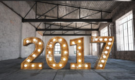 Retro 2017 bulb sign in empty warehouse