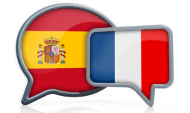Speech balloons with Spanish and French flags representing Spanish to French translation.