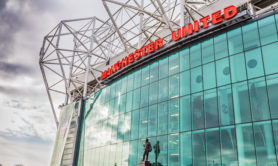 Manchester, England - February 28, 2016: The east stand of Old Trafford football stadium, home of Manchester United. With space for 75,957 spectators, Old Trafford has the second-largest capacity of any English football stadium after Wembley Stadium.