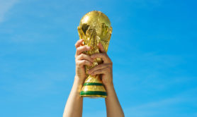 """""""Los Angeles, California, USA - May 12th 2010: Hands holding up a replica of the Soccer World Cup previous to South Africa's Tournament."""""""