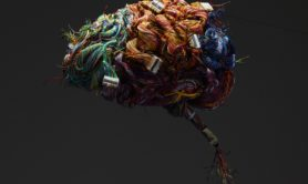 A model of the human brain constructed of wires and ports.