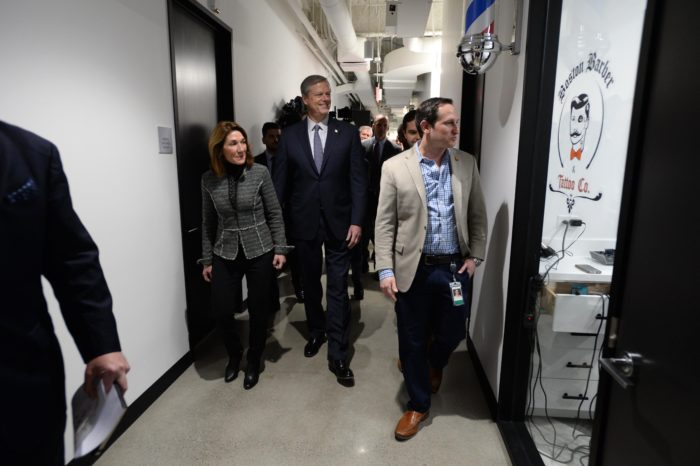 BOSTON, MA - MARCH 26: Massachusetts Governor Charlie Baker and Lt. Governor Karyn Polito receive a tour of the new Draftkings headquarters from CEO and Co-Founder Jason Robins (R) March 26, 2019 in Boston, Massachusetts. (Photo by Darren McCollester/Getty Images for DraftKings)