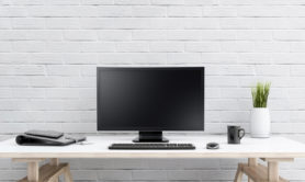 White brick wall, with PC working setup in front of it